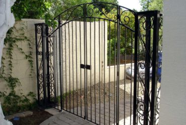 Hand forged steel entry gate with rivets and twisted steel