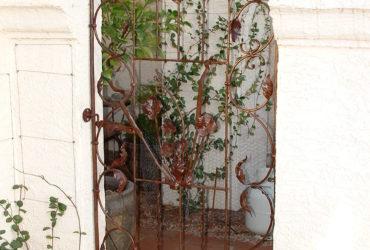 Hand forged steel floral garden gate