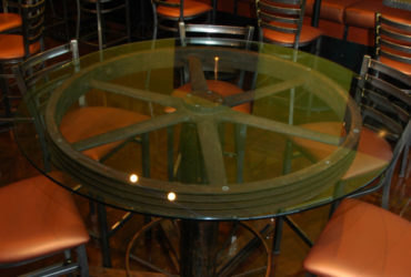 Table made from salvaged steel pulley wheel